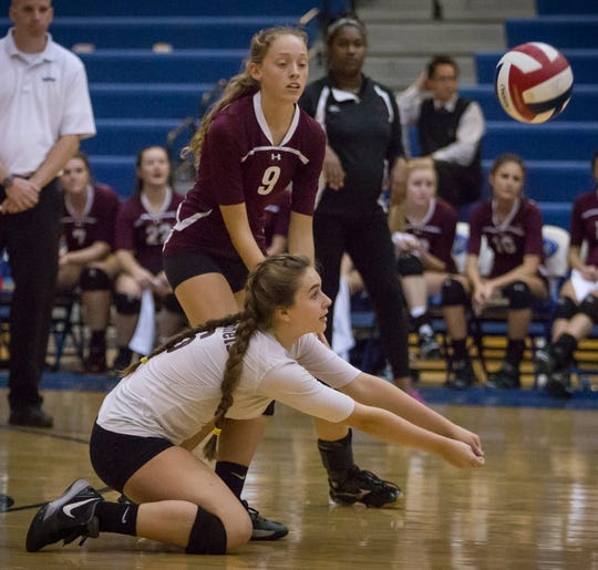 Henderson County's Cayce Chaykowsky (6) makes a pass to a teammate during the 2015 state volleyball tournament in Louisville. Teammate Kristin Logsdon looks on. The Lady Colonels defeated Raceland to win their first-ever match in state tournament play.