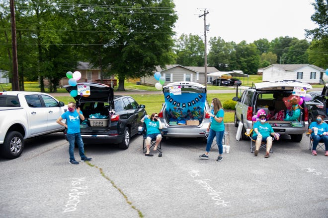 Teachers of Stigall Primary school in Humboldt, Tenn., tailgate to have students drive by and say good bye and have a happy summer to end the school year, Friday May, 21, 2020