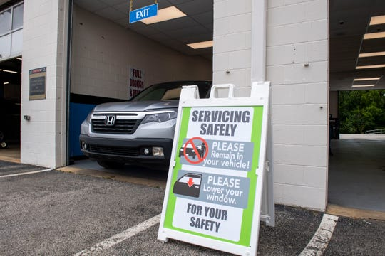 Honda Driver leaves the Service center at the Victory Honda of Jackson,Thursday, May 12, 2020. VHJ has implemented guidelines and safety protocol to protect the customers and employees.