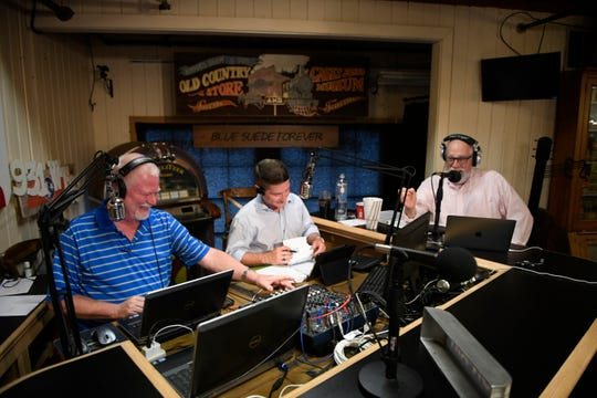 Brad McCoy, left, Dan Reaves, center and George Scott better know as George B., right, announce Reaves' new show on WTJS-FM 93.1.