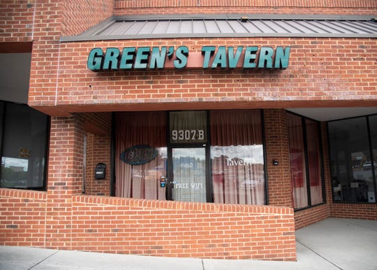 The tavern front of the now closed Green's Tavern in West Knoxville, Tenn., on Thursday, May 21, 2020. Opened in 2010, the tavern's owners announced its closure via social media on Friday, May 15, 2020.