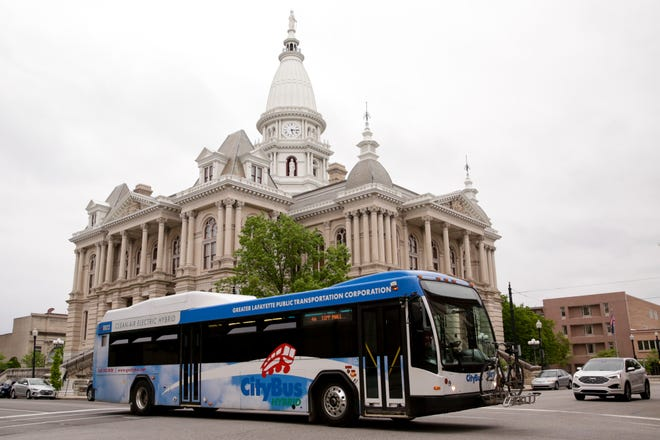 A CityBus drives past the Tippecanoe County Courthouse on Third Street, Thursday, May 21, 2020 in Lafayette.