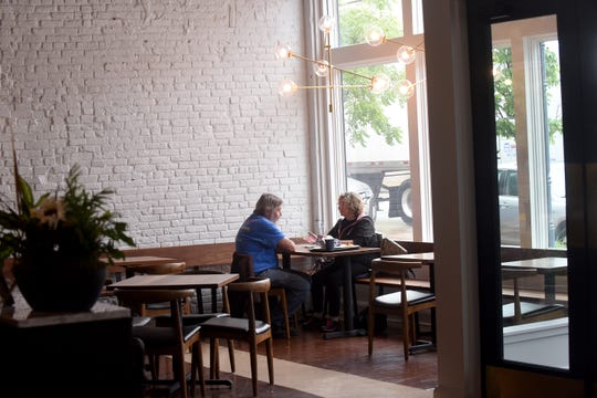 Don and Jan Bloom, of Lancaster, eat lunch in Provisions Bakery & Deli in downtown Lancaster. Restaurants throughout Ohio were allowed to reopen for in-person dinning, with new guidelines for health and safety amid the continuing coronavirus pandemic.