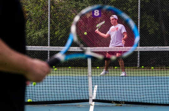 Max Fisher practices his return with father Brian Fisher  at Sam Peden Community Park in New Albany Friday morning, May 22, 2020. The Jeff high school student said the courts at the school were still closed so he and his dad -- with other Jeff students playing nearby -- decided to practice at the tennis courts in New Albany. May 22 marked the public opening of tennis and basketball courts at public parks.