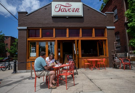 With the easing of coronavirus restrictions Rhonda Harding and Mark Flowers enjoyed lunch in front of The Tavern in Old Louisville. May 22, 2020