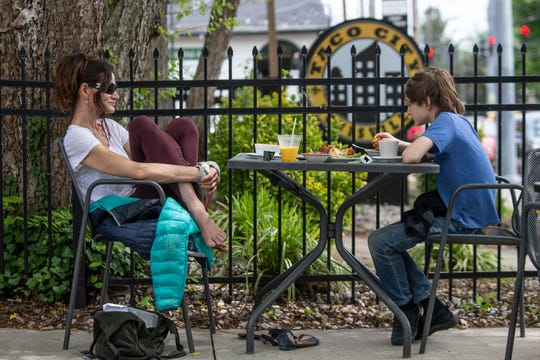 Jennie Wilson sat with her son Gaines Thomas, 13, sat on the patio for a meal at Kashmir Indian Restaurant on Bardstown Road. May 20, 2020