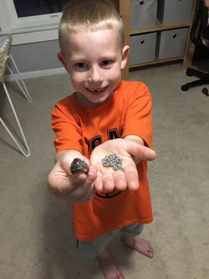 Jase Sauder, 6, of Lucas, found a 1983 class ring belonging to Yvonne Pollard, who now lives in Florida. His dad is sending the ring back to its grateful owner.
