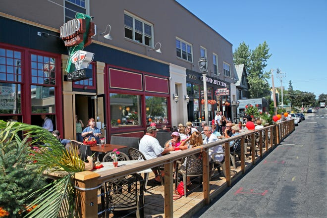 This is an example of a parklet, where space along the street is converted into outdoor dining space. Cudahy officials recently agreed to allow establishments to create such parklets in the city.