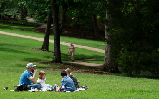 Dallas Owen enjoys picnic with his children Lela, Sosie and Jones at Cheekwood Gardens Friday, May 22, 2020 in Nashville, Tenn. Cheekwood reopened its 55-acre gardensFriday after closing due to the COVID-19 outbreak.
