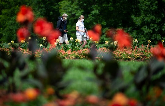 Mike and Virginia Niedermeyer enjoy a stroll through Cheekwood Gardens Friday, May 22, 2020 in Nashville, Tenn. Cheekwood reopened its 55-acre gardensFriday after closing due to the COVID-19 outbreak.