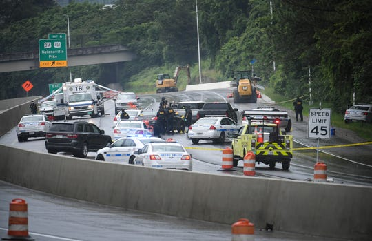 Tennessee Bureau of Investigations and Metro Police investigate a police involved shooting along Interstate 440 near Nolensville Pike. Friday, May 22, 2020 in Nashville, Tenn.
