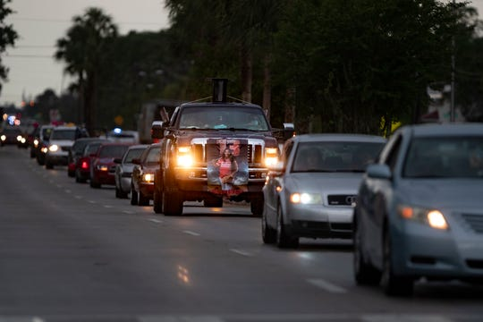 A convoy of vehicles carrying Immokalee High School graduating seniors, makes its way down South 1st Street, Friday, May 22, 2020, in Immokalee.