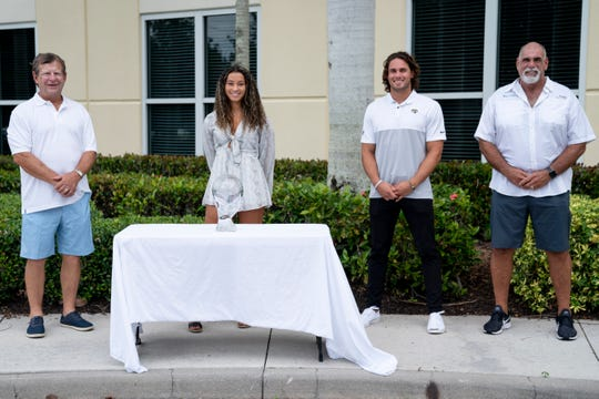 First Baptist Academy senior Malaya Melancon, center left, recipient of the Winged Foot Scholar-Athlete Award, poses for a portrait with Bud Hornbeck, left, Winged Foot Scholar-Athlete Award chairman, Michael Walker, center right, the 2015 recipient and wide receiver for the Jacksonville Jaguars, and Mike Walker, right, Winged Foot Scholar-Athlete Award board member, at Gallagher Lutgert Insurance in Naples on Friday, May 22, 2020.