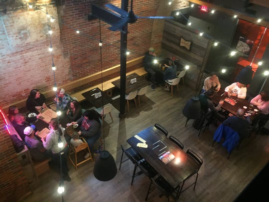 Dining parties were spaced out within the ground floor area of Donatos in Granville on Broadway on Thursday evening, the first day restaurants were allowed to welcome patrons back in, with certain restrictions in place.