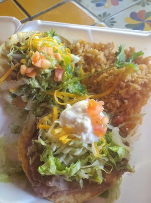 Two flat tostadas (one chicken, one beef), topped with refried beans, lettuce, tomatoes, cheese, guacamole, and sour cream. Served with a side of Spanish rice and a free large iced tea. $6.99 at La Nueva Casita Cafe, 195 N. Mesquite St.