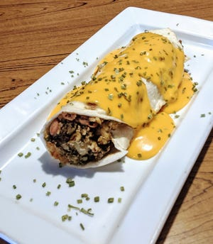 Green chile con carne burrito with rice and beans inside. for $5.99 at Jake's Cafe, 1340 E. Lohman Ave.