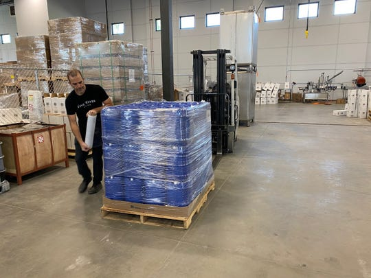 Five-gallon jugs of hand sanitizer produced by Ogden's Own Distillery are readied for delivery from Ogden, Utah to Shiprock on May 19.