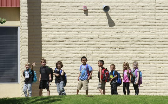 Students wait to be picked up Wednesday, Aug. 31, 2016,  at Ladera Del Norte Elementary School in Farmington.