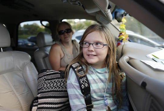 Samantha Leppert picks up her daughter Katlynn Bentley on Wednesday, Aug. 31, 2016, at Ladera Del Norte Elementary School in Farmington.