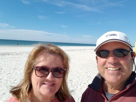 Valerie and Dave Mamo of Milford, enjoying a white sand beach in Alabama, a stop during their tour of America's Great Loop by boat.