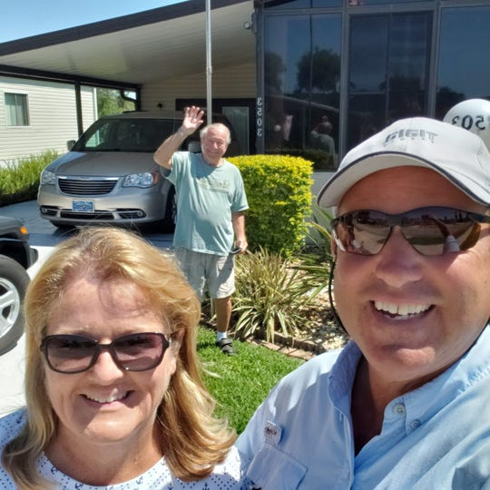 Valerie and Dave Mamo visited Bob Wilson, Val's father, from a social distance in Titusville, Fla. after coronavirus hit while they were traveling on America's Great Loop.