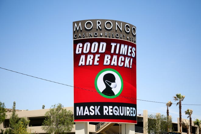 A sign advertises Morongo Casino & Resort's reopening on Friday, May 22, 2020, in Cabazon, Calif. after closing temporarily due to the coronavirus pandemic.