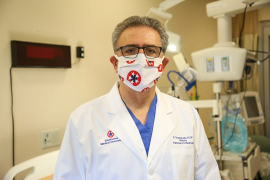"""Dr. Shahriyar Tavakoli, Eisenhower Health critical care medical director, stands in an intensive care unit room at Eisenhower Health in Rancho Mirage, Calif. on Friday, May 22, 2020. """"The pandemic has completely changed how we provide nursing care,"""" Tavakoli said."""