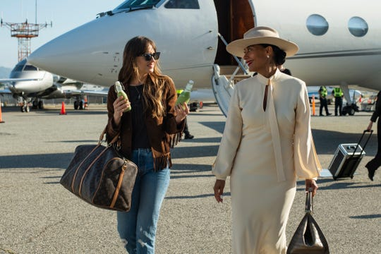 """Dakota Johnson and Tracee Ellis Ross exit a private jet in """"The High Note."""""""