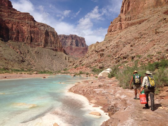 Fish biologists working with Arizona Game and Fish Department and U.S. Fish and Wildlife Service walk along the Little Colorado River while conducting surveys of native fish in 2015.