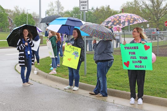 Woodmore Elementary and Middle School staff surrounded the Woodville school building on May 21 to let parents and students drive by to say their goodbyes.