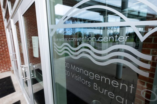 A sign posted on the doors of the Blue Water Convention Center tells visitors that all public and consumer shows have been canceled during the coronavirus pandemic.