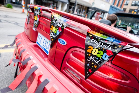 Decorated cars parade through downtown Port Huron Friday afternoon, May 22, 2020, in celebration of Port Huron Schools seniors who are graduating this year.