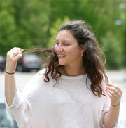 Ally Dencker of Newburgh has only had to trim a few ends of her hair, photographed in Beacon on May 22, 2020.