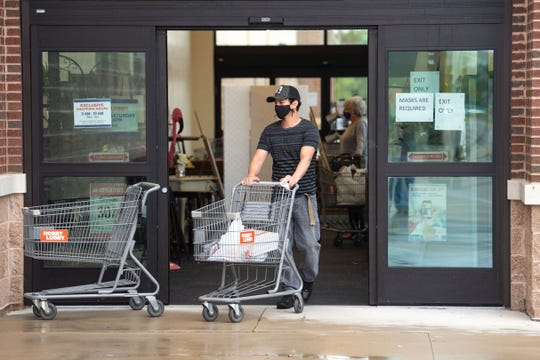 """York County was back in business on Friday as it moved into the """"yellow"""" phase under the state's coronavirus reopening plans. Francisco Barajas took the opportunity to shop at Hobby Lobby in West Manchester Township, where masks were required."""