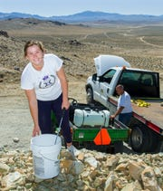 Yerington High School Senior Natalee Hurt  prepares to mix paint during Yerington's Y Hill Cleanup Day.