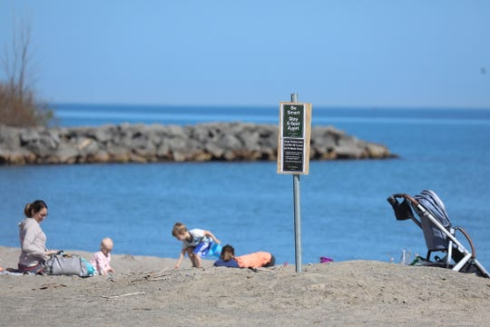 The beach at Hamlin Beach State Park slowly fills with people on Friday, May 22, 2020.