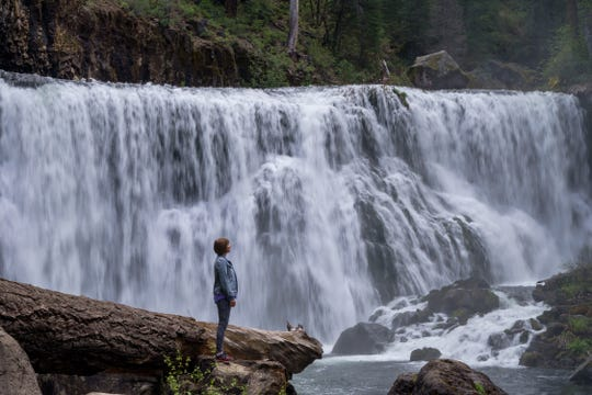 Heather Dye of New Orleans, Louisiana stands at McCloud River's Middle Fall, one of three waterfalls in the mountain community on Tuesday morning, May 19, 2020. Dye was visiting a cousin in Redding.