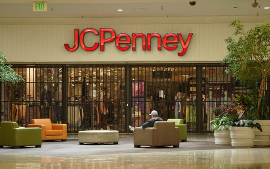 A man sits near the front entrance to the JCPenney store at the Mt. Shasta Mall on Monday, May 18, 2020. It was the mall's first day reopening, about two months since it closed due to the COVID-19 pandemic. Macy's has reopened.