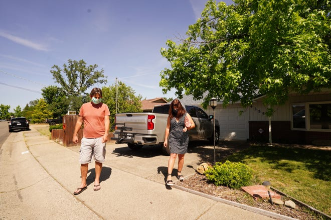 Sandy Dole, right, with Vista Real Estate, had a walk through again with Steve Ralston at the property on Emily Way in Redding on Friday, May 8, 2020.