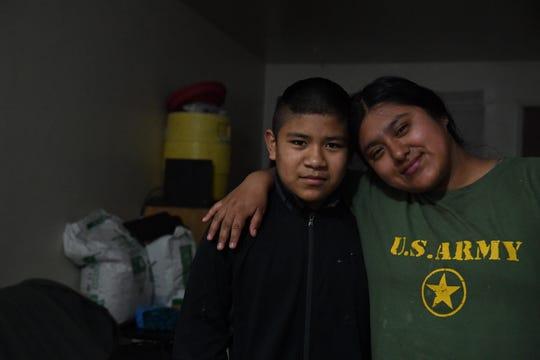 Aldo Salvador, a la izquierda, y su hermana Resi aparecen juntos en esta foto, en su departamento de dos dormitorios en el lado norte de Salinas, el sábado 16 de mayo de 2020.