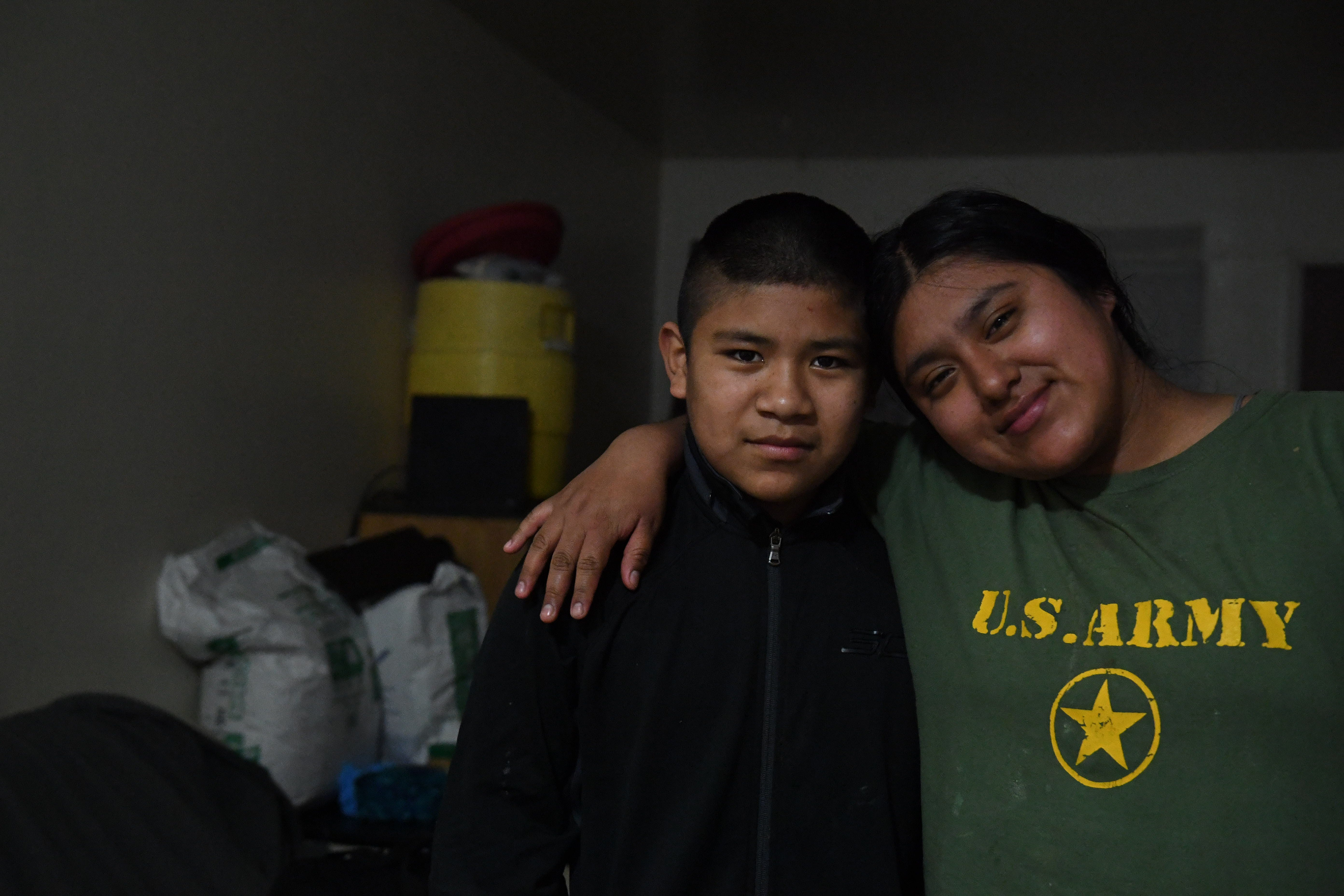 Aldo Salvador, left, and his sister Resi are photographed together inside their two room apartment on the north side of Salinas on Saturday, May 16, 2020.