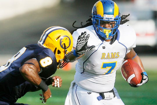 Angelo State's Tristan Carter tries to fend off a Texas A&M-Commerce defender during the Harvey Martin Classic at the Cotton Bowl in Dallas on Sept. 11, 2010.