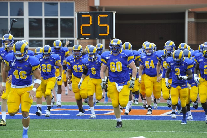 The Angelo State Rams run onto the field before a game at LeGrand Stadium at 1st Community Credit Union Field.