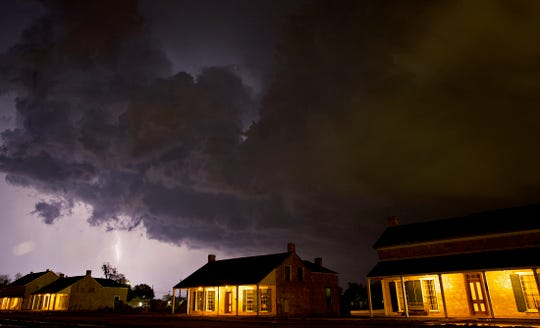 Storm clouds and lightning can be seen behind Fort Concho during severe weather Thursday, May 21, 2020.