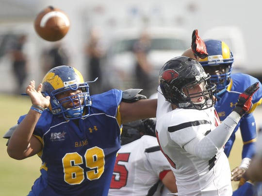 Angelo State's Isi Cocker (69) was an all-conference lineman for the Rams in 2012 and '13.