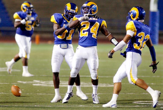 Angelo State's Alvin Johnson (24) gets the ball back for the Rams while playing Texas A&M Kingsville at San Angelo Stadium on Oct. 9, 2010.