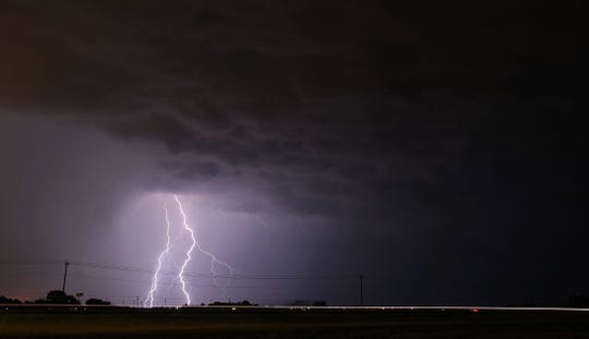 Storm clouds and lightning can be seen south of San Angelo during severe weather Thursday, May 21, 2020.