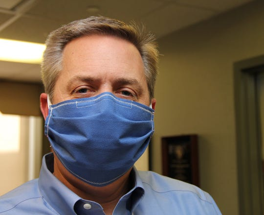 """""""Peninsula Regional Health System CEO, Dr. Steve Leonard, practicing what he encourages us all to do: protect others in our hospital by covering up,"""" posted Peninsula Regional Medical Center to Facebook April 14, 2020."""