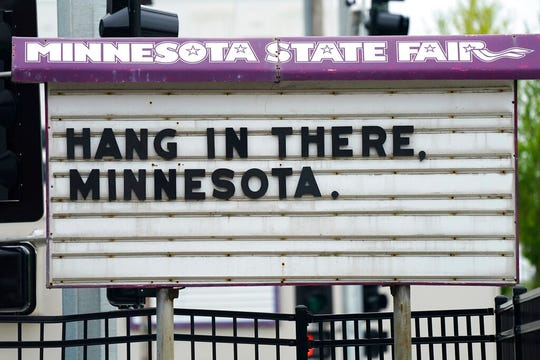 A sign of encouragement amid the coronavirus pandemic stands at the main entrance to the State Fairgrounds, Thursday, May 21, 2020, in St. Paul.