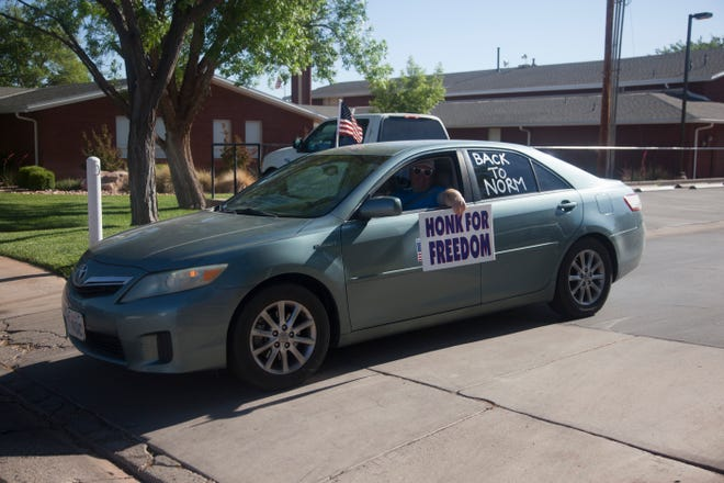 Drivers gather in Ivins for a Road Rally for Freedom to promote the end of COVID-19 quarantine regulations Thursday, May 21, 2020. After decorating their vehicles with flags and slogans, the group drove through Washington County from Ivins to Hurricane.